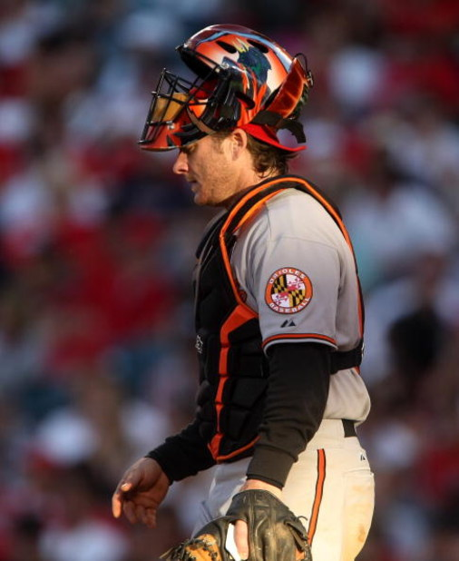 ANAHEIM, CA - JULY 04:  Catcher Gregg Zaun  #9 of the Baltimore Orioles walks to the mound in the game against the Los Angeles Angels of Anaheim on July 4, 2009 at Angel Stadium in Anaheim, California.  (Photo by Stephen Dunn/Getty Images)