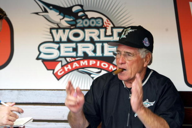 MIAMI - APRIL 10:  Manager of the Florida Marlins Jack McKeon celebrates his World Series ring during the game against the Philadelphia Phillies on April 10, 2004 at Pro Player Stadium in Miami, Florida.  (Photo by Victor Baldizon/Getty Images)