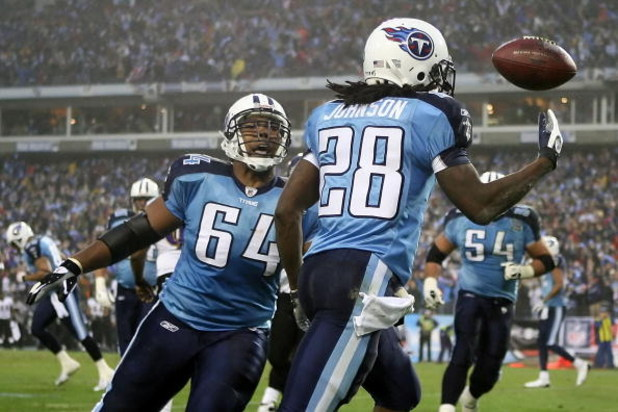 NASHVILLE, TN - JANUARY 10:  Running back Chris Johnson #28 of the Tennessee Titans throws the ball up in the air and celebrates with teammate center Leroy Harris #64 after Johnson scored on an eight yard touchdown run in the first quarter against the Bal
