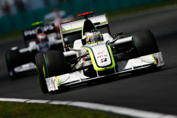 BUDAPEST, HUNGARY - JULY 26:  Jenson Button of Great Britain and Brawn GP holds off the challenge of Kazuki Nakajima of Japan and Williams as they battle on the track during the Hungarian Formula One Grand Prix at the Hungaroring on July 26, 2009 in Budap