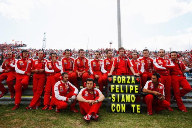 BUDAPEST, HUNGARY - JULY 26:  Ferrari team send their support to their injured driver Felipe Massa of Brazil before the Hungarian Formula One Grand Prix at the Hungaroring on July 26, 2009 in Budapest, Hungary.  (Photo by Mark Thompson/Getty Images)