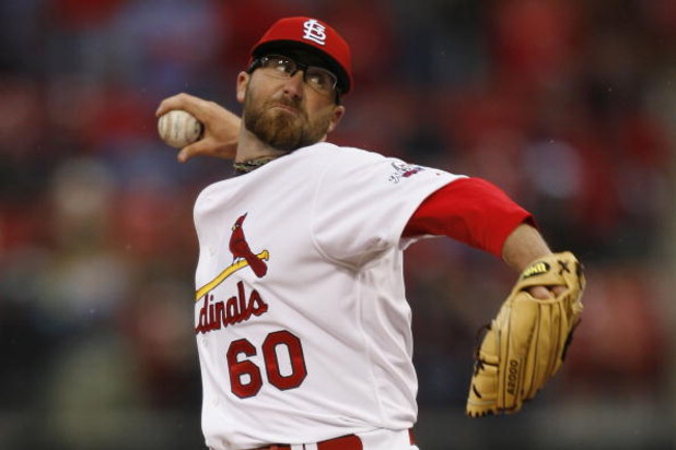 ST. LOUIS, MISSOURI - APRIL 6:  Relief pitcher Jason Motte #60 of the St. Louis Cardinals throws against the Pittsburgh Pirates during Opening Day on April 6, 2009 at Busch Stadium in St. Louis, Missouri.  The Pirates beat the Cardinals 6-4.  (Dilip Vishw