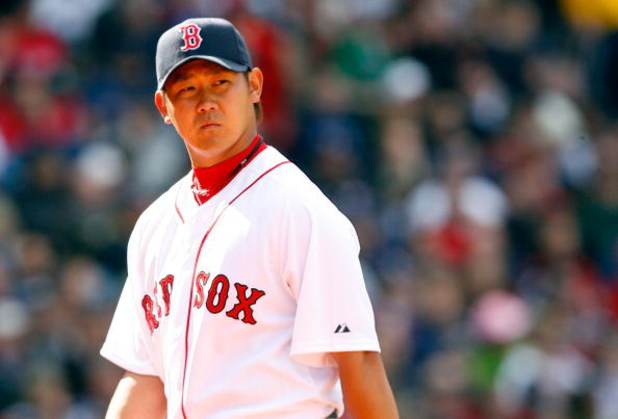 BOSTON - APRIL 9: Daisuke Matsuzaka #18 of the Boston Red Sox reacts after a rough inning against the Tampa Bay Rays at Fenway Park April 9, 2009, in Boston, Massachusetts. (Photo by Jim Rogash/Getty Images)