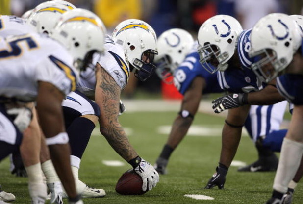 INDIANAPOLIS - JANUARY 13:  Center Nick Hardwick #61 of the San Diego Chargers centers the ball at the line of scrimmage on offense against the Indianapolis Colts during their AFC Divisional Playoff game at the RCA Dome on January 13, 2008 in Indianapolis
