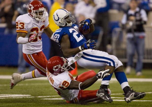 INDIANAPOLIS - NOVEMBER 18:  Joseph Addai #29 of the Indianapolis Colts is tackled by Bernard Pollard #49 of the Kansas City Chiefs on November 18, 2007 at the RCA Dome in Indianapolis, Indiana. The Colts defeated the Chiefs 13-10.  (Photo by Dilip Vishwa