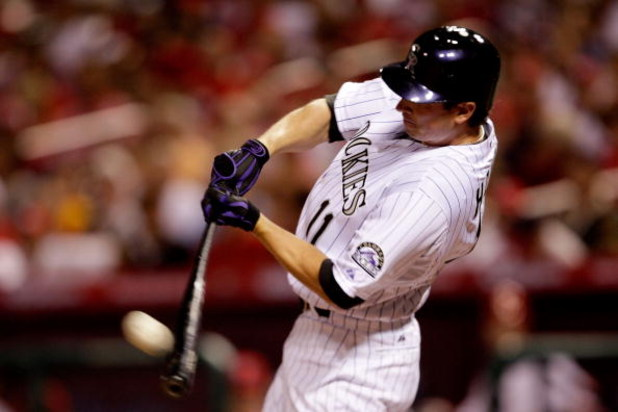 ST LOUIS, MO - JULY 14:  National League All-Star Brad Hawpe of the Colorado Rockies hits a deep fly that was caught by Carl Crawford of the Tampa Bay Reys against the fence during the 2009 MLB All-Star Game at Busch Stadium on July 14, 2009 in St Louis,