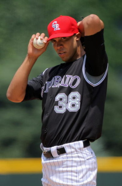 DENVER - JULY 05:  Starting pitcher Ubaldo Jimenez #38 of the Colorado Rockies delivers against the Arizona Diamondbacks during MLB action at Coors Field on July 5, 2009 in Denver, Colorado. Jimenez collected the loss as the Diamondbacks defeated the Rock