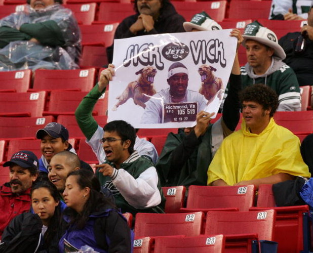 EAST RUTHERFORD, NJ - AUGUST 10: Fans hold up a banner in reference to Atlanta Falcon quarterback Michael Vick as the New York Jets play the Falcons at Giants Stadium August 10, 2007 in East Rutherford, New Jersey. Vick is facing charges of dogfighting.