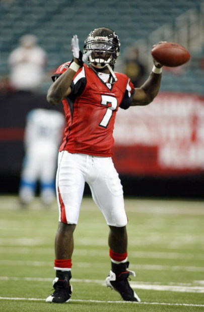 ATLANTA - DECEMBER 24: Quarterback Michael Vick #7 of the Atlanta Falcons passes the ball before the game against the Carolina Panthers on December 24, 2006 at The Georgia Dome in Atlanta,Georgia. (Photo by Marc Serota/Getty Images)