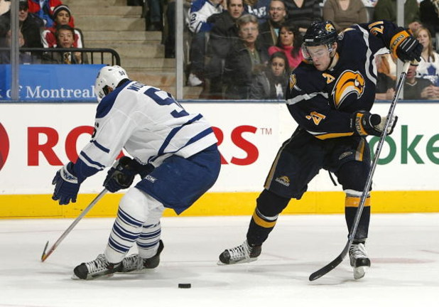 TORONTO - FEBRUARY 27:  Drew Stafford #21of the Buffalo Sabres beats Andy Wozniewski #56 of the Toronto Maple Leafs on this play in NHL action at the Air Canada Centre February 27, 2007 in Toronto, Ontario.  (Photo By Dave Sandford/Getty Images)