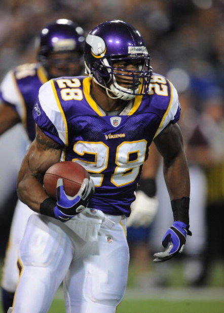 MINNEAPOLIS - DECEMBER 21:  Adrian Peterson #28 of the Minnesota Vikings carries the ball during an NFL game against the Atlanta Falcons at the Hubert H. Humphrey Metrodome, on December 21, 2008 in Minneapolis, Minnesota.  (Photo by Tom Dahlin/Getty Image