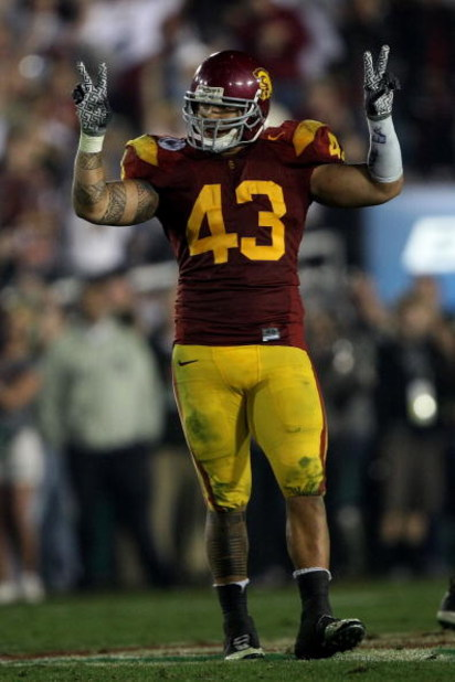 PASADENA, CA - JANUARY 01:  Kaluka Maiava #43 of the USC Trojans celebrates near the end of the Trojans' win over the Penn State Nittany Lions at the 95th Rose Bowl Game presented by Citi on January 1, 2009 at the Rose Bowl in Pasadena, California.  (Phot