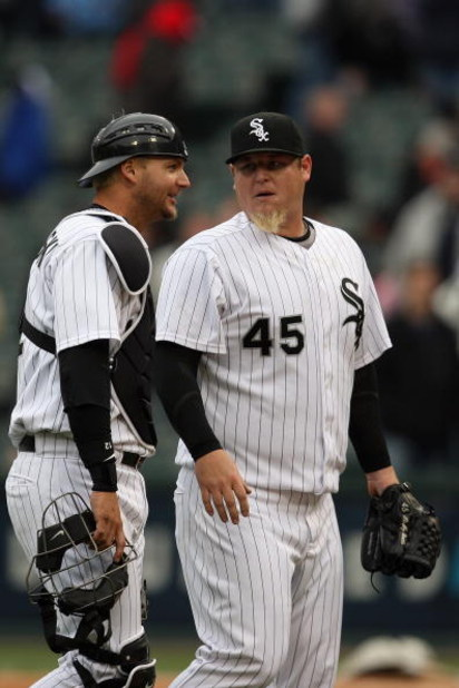CHICAGO - APRIL 29:  A.J. Pierzynski #12 meets with Bobby Jenks #45 of the Chicago White Sox during the game against the Seattle Mariners on April 29, 2009 at U.S. Cellular Field in Chicago, Illinois. (Photo by Jonathan Daniel/Getty Images)