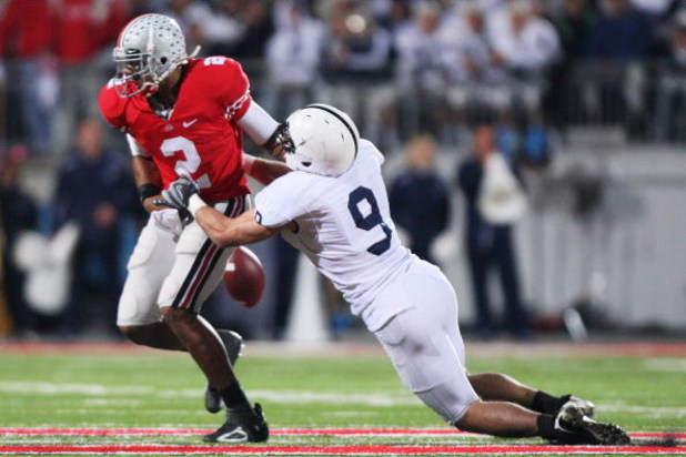COLUMBUS, OH - OCTOBER 25: Quarterback Terrell Pryor #2 of the Ohio State Buckeyes fumbles the ball after being hit by defensive back Mark Rubin #9 of the Penn State Nittany Lions on October 25, 2008 at Ohio Stadium in Columbus, Ohio. Penn State recovered