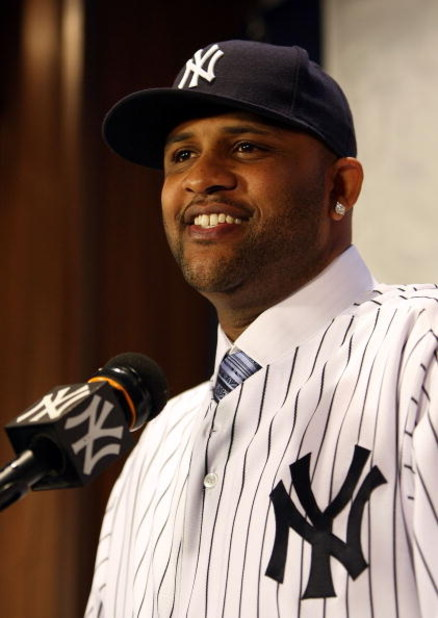 NEW YORK - DECEMBER 18:  CC Sabathia talks to the media during a press conference to announce his signing to the New York Yankees at Yankee Stadium on December 18, 2008  in the Bronx borough of New York City.  (Photo by Nick Laham/Getty Images)