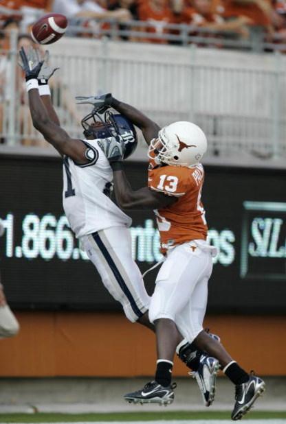 AUSTIN, TX - SEPTEMBER 22:  Ryan Palmer #13 of the Texas Longhorns blocks the vision of Jarrett Dillard #81 of the Rice Owls to prevent a touchdown in the first quarter on September 22, 2007 at  Darrell K. Royal-Texas Memorial Stadium  in Austin, Texas.