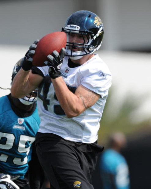 JACKSONVILLE, FL - MAY 1:  Tight end Zach Miller #49 of the Jacksonville Jaguars grabs a pass during a team mini-camp on May 1, 2009 on the practice fields at Jacksonville Municipal Stadium in Jacksonville, Florida.  (Photo by Al Messerschmidt/Getty Image
