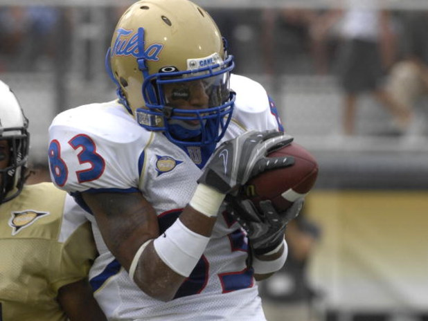 ORLANDO, FL - OCTOBER 20: Wide receiver Trae Johnson #83 of the Tulsa Golden Hurricane grabs a pass against the University of Central Florida Knights at Bright House Stadium on October 20, 2007 in Orlando, Florida.  UCF won 44 - 23. (Photo by Al Messersch