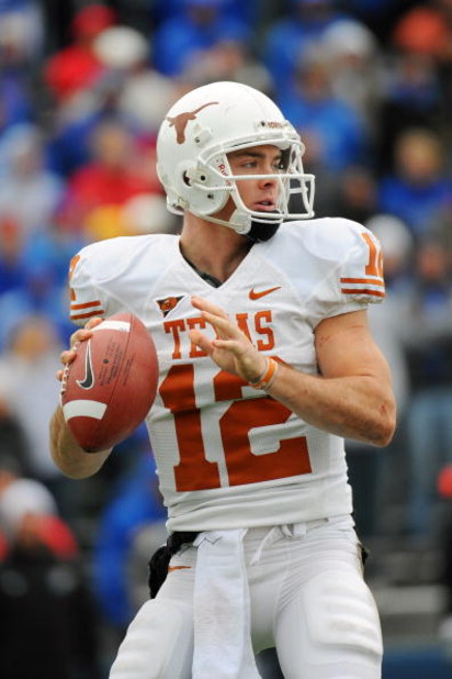 LAWRENCE, KS - NOVEMBER 15:  Colt McCoy #12 of the Texas Longhorns looks to throw against the Kansas Jayhawks on November 15, 2008 at Memorial Stadium in Lawrence, Kansas.  Texas defeated Kansas 35-7. (Photo by G. Newman Lowrance/Getty Images)