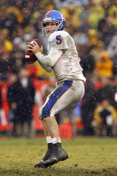 KANSAS CITY, MO - NOVEMBER 29:  Quarterback Todd Reesing #5 of the Kansas Jayhawks looks to pass the ball downfield during the game against the Missouri Tigers on November 29, 2008 at Arrowhead Stadium in Kansas City, Missouri. (Photo by Jamie Squire/Gett