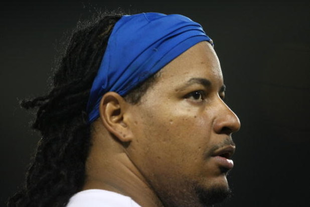 LOS ANGELES, CA - JULY 16:  Manny Ramirez #99 of the Los Angeles Dodgers looks on during the game against the Houston Astro's on July 16, 2009 at Dodger Stadium in Los Angeles, California.  (Photo by Stephen Dunn/Getty Images)