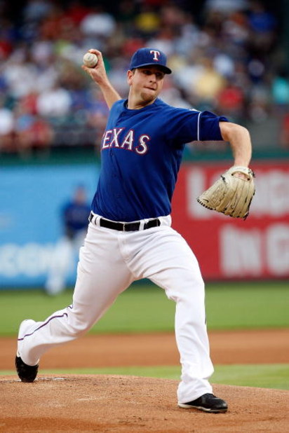 ARLINGTON, TX - JULY 29:  Pitcher Scott Feldman #39 of the Texas Rangers throws against the Detroit Tigers on July 29, 2009 at Rangers Ballpark in Arlington, Texas.  (Photo by Ronald Martinez/Getty Images)