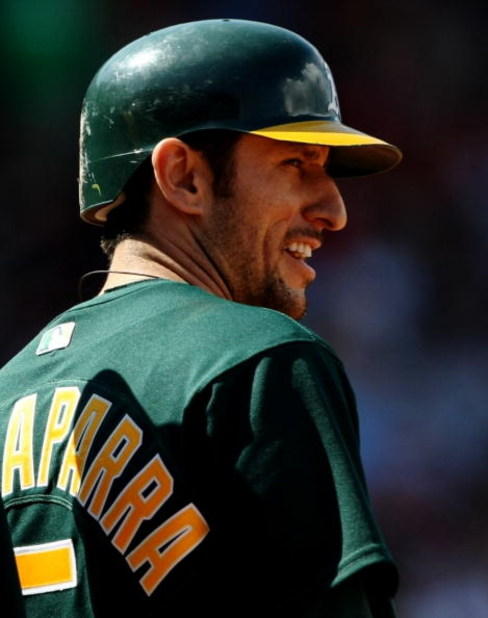 BOSTON - JULY 30:  Designated hitter Nomar Garciaparra #5 of the Oakland A's looks on from first base after hitting a single against the Boston Red Sox on July 30, 2009 at Fenway Park in Boston, Massachusetts.  (Photo by Elsa/Getty Images)