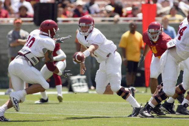 LOS ANGELES, CA - APRIL 25: Quarterback Matt Barkley #7 of the USC Trojans hands off the ball during the spring game on April 25, 2009 at the Los Angeles Memorial Coliseum in Los Angeles, California.  The cardinal team won 16-10.  (Photo by Jeff Golden/Ge