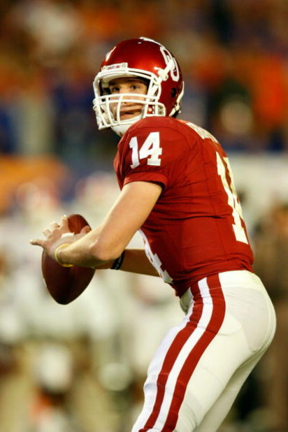 MIAMI - JANUARY 08:  Sam Bradford #14 of the Oklahoma Sooners look to pass against the Florida Gators during the FedEx BCS National Championship game at Dolphin Stadium on January 8, 2009 in Miami, Florida.  (Photo by Marc Serota/Getty Images)