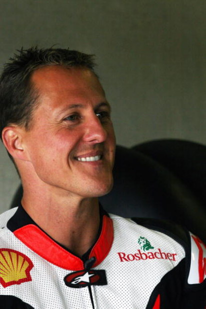 HOHENSTEIN-ERNSTTHAL, GERMANY - JUNE 12: Michael Schumacher of Germany and Holzhauer Racing Team smiles during the International German Championship IDM training session at Sachsenring racetrack on June 12, 2009 in Hohenstein-Ernstthal, Germany. Schumache