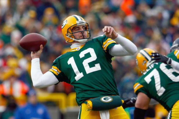 GREEN BAY - DECEMBER 7:  Quarterback Aaron Rodges #12 of the Green Bay Packers passes the ball during the game against the Houston Texans at Lambeau Field on December 7, 2008 in Green Bay, Wisconsin.  ( Photo by: Jeff Gross/Getty Images)