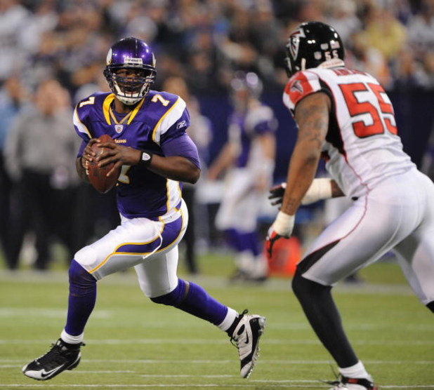 MINNEAPOLIS - DECEMBER 21:  Tarvaris Jackson #7  of the Minnesota Vikings scrambles under pressure from John Abraham #55 of the Atlanta Falcons during an NFL game at the Hubert H. Humphrey Metrodome, on December 21, 2008 in Minneapolis, Minnesota.  (Photo