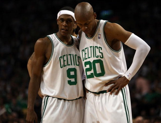BOSTON - MAY 17:  Rajon Rondo #9 and Ray Allen #20 of the Boston Celtics talk as the Orlando Magic shoot a free throw in Game Seven of the Eastern Conference Semifinals during the 2009 NBA Playoffs at TD Banknorth Garden on May 17, 2009 in Boston, Massach
