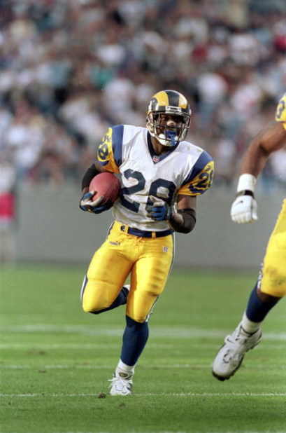 5 Dec 1999: Marshall Faulk #28 of the St. Louis Rams carries the ball during a game against the Carolina Panthers at the Ericsson Stadium in Charlotte, North Carolina. The Rams defeated the Panthers 34-21. Mandatory Credit: Ezra O. Shaw  /Allsport