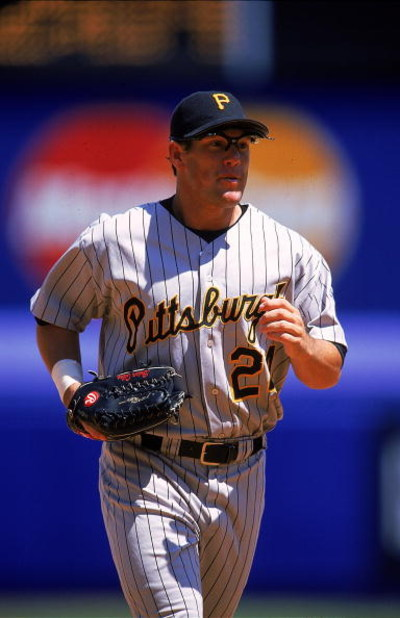 28 Jul 1999: Brian Giles #24 of the Pittsburgh Pirates runs off the field during the game against the New York Mets at Shea Stadium in Flushing, New York. The Mets defeated the Pirates 9-2.