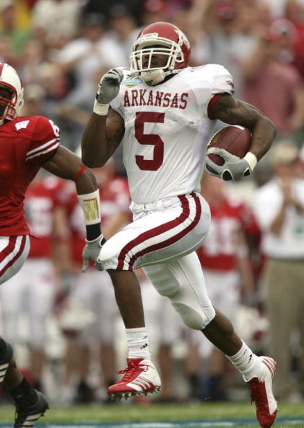 ORLANDO, FL - JANUARY 01:  Running back Darren McFadden #5 of the Arkansas Razorbacks runs for a long gain in the first quarter against the Wisconsin Badgers in the Capitol One Bowl at Florida Citrus Bowl on January 1, 2007 in Orlando, Florida.  (Photo by