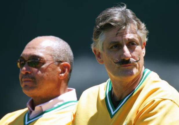OAKLAND, CA - JULY 17: Reggie Jackson and Rollie Fingers look on as the Oakland Athletics celebrate the 30th anniversary of their 1974 World Championship team before the game against the Chicago White Sox at the Network Associates Coliseum on July 17, 200