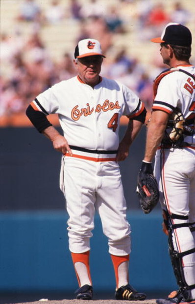 11 May 1986:  Manager Earl Weaver (left) of the Baltimore Orioles talks with catcher Rick Dempsey on the mound during a pitching change in an Orioles home game.   Mandatory Credit: Allsport USA/ALLSPORT