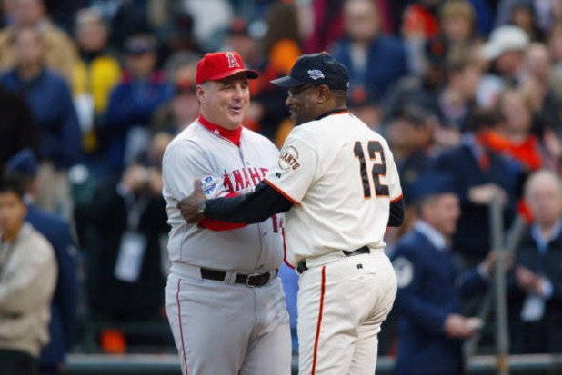 SAN FRANCISCO - OCTOBER 22:  Manager Dusty Baker of the San Francisco Giants and Manager Mike Sciosia of the Anaheim Angels shake hands prior to the start of game three of the World Series on October 22, 2002 at Pacific Bell Park in San Francisco, Califor