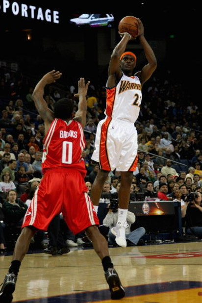 OAKLAND, CA - DECEMBER 12:  Anthony Morrow #22 of the Golden State Warriors goes up for a shoto ver Aaron Brooks #0 of the Houston Rockets during the game on December 12, 2008 at Oracle Arena in Oakland, California.  The Rockets won 119-108.  NOTE TO USER