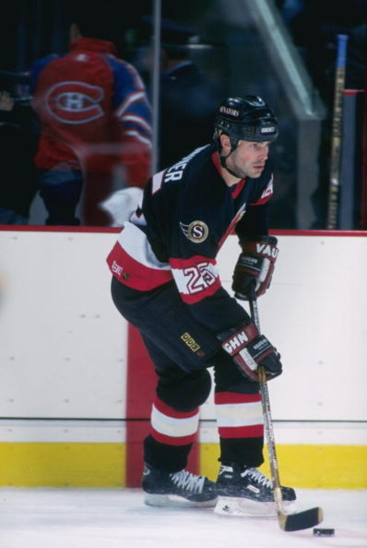 15 Mar 1997: Center Bruce Gardiner of the Ottawa Senators moves down the ice during a game against the Montreal Canadiens at The Forum in Montreal, Quebec. The game was a tie, 2-2.