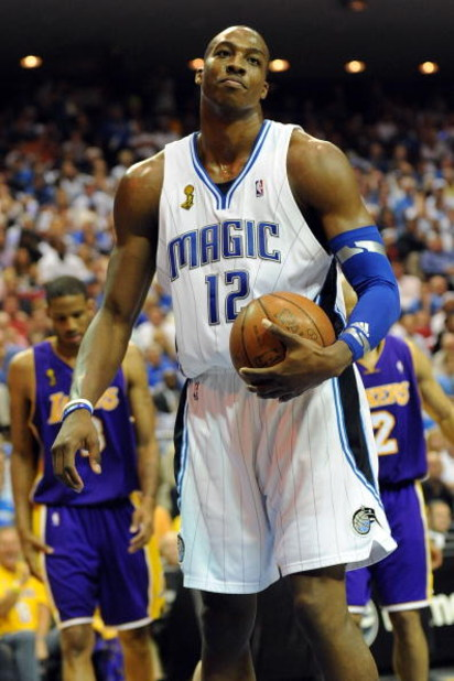 ORLANDO, FL - JUNE 14:  Dwight Howard #12 of the Orlando Magic reacts in the third quarter of Game Five of the 2009 NBA Finals against the Los Angeles Lakers on June 14, 2009 at Amway Arena in Orlando, Florida.  NOTE TO USER:  User expressly acknowledges