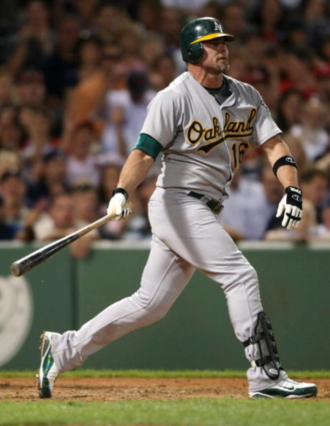 BOSTON - JULY 6:   Jason Giambi #16 of the Oakland Athletics strikes out against the Boston Red Sox at Fenway Park on July 6, 2009 in Boston, Massachusetts. (Photo by Elsa/Getty Images)