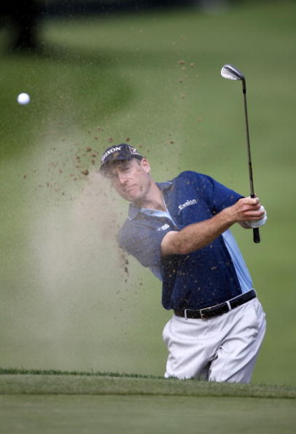 GRAND BLANC, MI - JULY 30:  Jim Furyk hits from a green side bunker on the first hole during the first round of the Buick Open at Warwick Hills Golf and Country Club on July 30, 2009 in Grand Blanc, Michigan.  (Photo by Gregory Shamus/Getty Images)