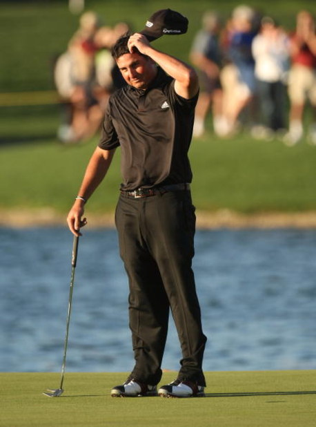 LA QUINTA, CA - JANUARY 25:  Pat Perez reacts after sinking the final putt for a three stroke victory on the Palmer Private course at PGA West during the final round of the Bob Hope Chrysler Classic on January 25, 2009 in La Quinta, California.  (Photo by
