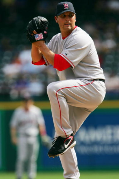 ARLINGTON, TX - APRIL 3:  Keith Foulke #29 of the Boston Red Sox pitches against the Texas Rangers during the Opening Day game at Ameriquest Field in Arlington on April 3, 2006 in Arlington, Texas. The Red Sox won 7-3.  (Photo by Ronald Martinez/Getty Ima