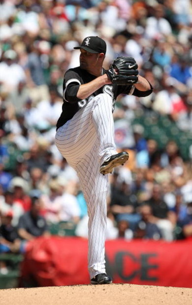 CHICAGO - JUNE 28: Starting pitcher John Danks #50 of the Chicago White Sox prepares to deliver the ball against the Chicago Cubs on June 28, 2009 at U.S. Cellular Field in Chicago, Illinois. The White Sox defeated the Cubs 6-0. (Photo by Jonathan Daniel/