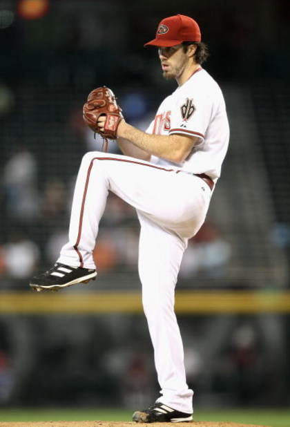 PHOENIX - APRIL 22:  Starting pitcher Dan Haren #15 of the Arizona Diamondbacks pitches against the Colorado Rockies during the game at Chase Field on April 22, 2009 in Phoenix, Arizona. The Diamondbacks defeated the Rockies 2-0.  (Photo by Christian Pete