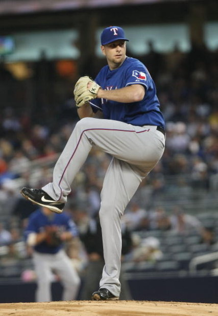 NEW YORK - JUNE 03:  Scott Feldman #39 of the Texas Rangers pitches against the New York Yankees on June 3, 2009 at Yankee Stadium in the Bronx borough of New York City.  (Photo by Nick Laham/Getty Images)