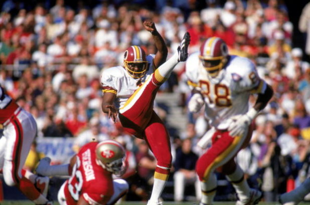 WASHINGTON - NOVEMBER 6:  Kicker Reggie Roby #1 of the Washington Redskins punts the ball during a game against San Francisco 49ers at RFK Memorial Stadium on November 6, 1994 in Washington, DC.  The 49ers won 37-22.  (Photo by Doug Pensinger/Getty Images
